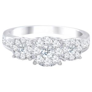 White gold illusion set three stone diamond cluster ring