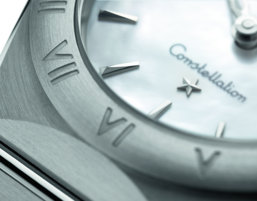 Close up of Omega Constellation watch dial with signature star logo.