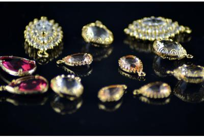 various gemstone and crystal jewellery laid on a black background