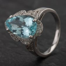 Second Hand 14ct White Gold Pear Cut Aquamarine Centre Stone with Surrounding Diamond Ring