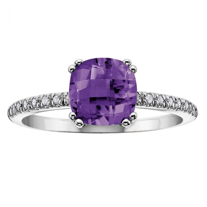 silver ring with round purple amethyst stone and diamonds on the ring's shoulders