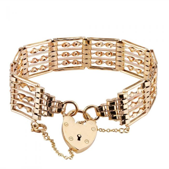 Gold link bracelet with heart padlock