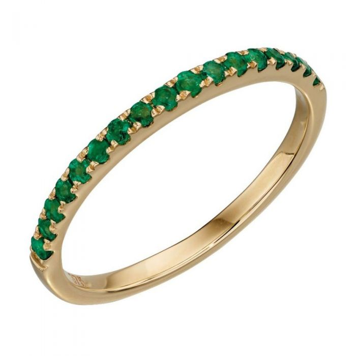 gold half eternity ring with green emerald stones