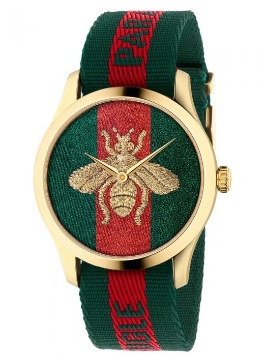 gucci watch with fabric strap and watch face and bee emblem design