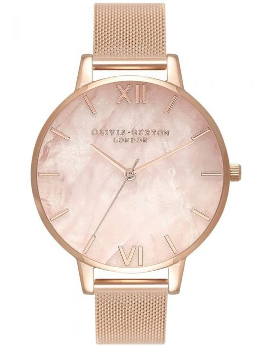 a gold mesh strap watch with a rose quartz face