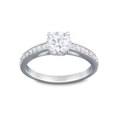 a sworvski crystal silver solitaire ring with stone-set shoulders
